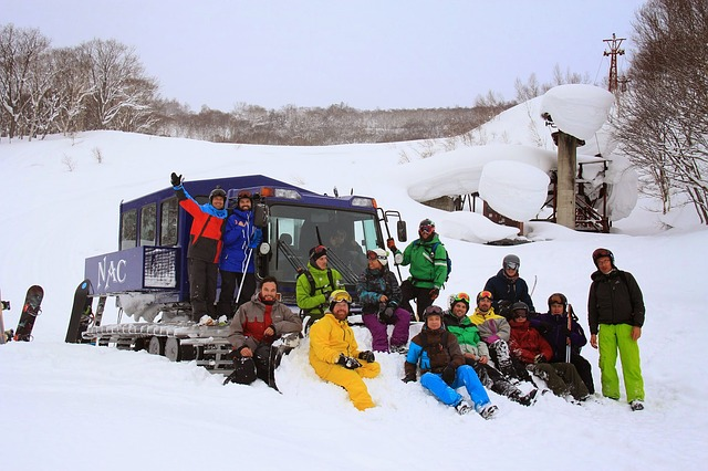 Group of skiers and snowboarders sitting in the snow